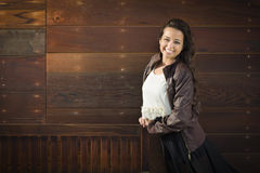 Mixed Race Young Adult Woman Portrait Against Wooden Wall Royalty Free Stock Image