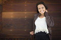 Mixed Race Young Adult Woman Portrait Against Wooden Wall Stock Photography