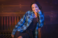 Mixed Race Young Adult Woman Portrait Sitting on Wood Bench Royalty Free Stock Images