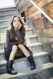 Mixed Race Young Adult Woman Portrait on Staircase Royalty Free Stock Image