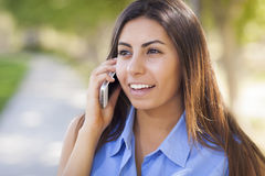 Mixed Race Young Adult Woman Using Her Cell Phone Royalty Free Stock Photos