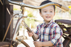 Mixed Race Young Boy Having Fun on the Bicycle Royalty Free Stock Photography
