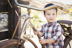 Mixed Race Young Boy Having Fun on the Bicycle Royalty Free Stock Photos
