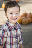 Mixed Race Young Boy Having Fun at the Pumpkin Patch Royalty Free Stock Photo