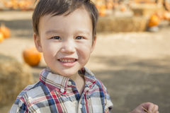 Mixed Race Young Boy Having Fun at the Pumpkin Patch Stock Photo