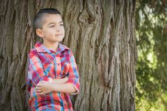 Pensive Mixed Race Young Boy Standing Outdoors. Mixed Race Young Boy Standing Outdoors stock photography