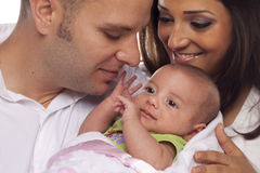 Mixed Race Young Couple with Newborn Baby stock photography