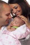 Mixed Race Young Couple with Newborn Baby Royalty Free Stock Photos