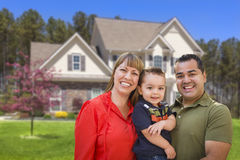 Mixed Race Young Family in Front of House Stock Images