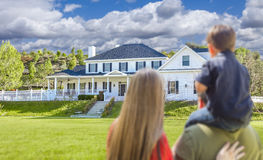 Mixed Race Young Family Looking At Beautiful Home Royalty Free Stock Photos