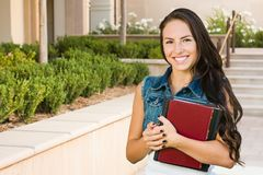 Mixed Race Young Girl Student with School Books On Campus Stock Photos