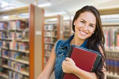 Mixed Race Young Girl Student with School Books Inside Library Royalty Free Stock Image
