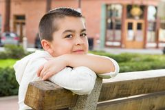 Mixed Race Young Hispanic Caucasian Boy on a Park Bench. Portrait of Mixed Race Young Hispanic and Caucasian Boy royalty free stock photo