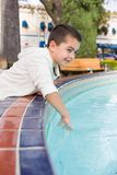 Mixed Race Young Hispanic and Caucasian Boy at a Water Fountain. Portrait of Mixed Race Young Hispanic and Caucasian Boy stock images