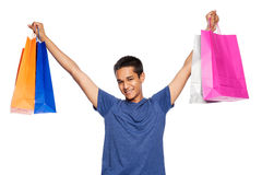 Mixed Race Young Man with Colourful Shopping Bags. Royalty Free Stock Photo
