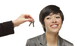 Mixed Race Young Woman Being Handed Keys on White stock photo
