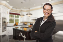 Mixed Race Young Woman Standing in Beautiful Custom Kitchen Stock Photography