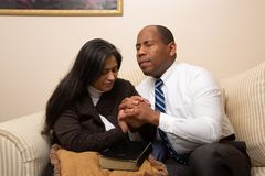 Mixed Raced Christian Couple Praying Together stock photography