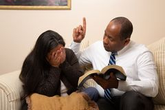 Mixed Raced Christian Couple Studying Bible Together stock images