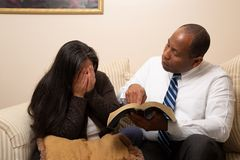 Mixed Raced Christian Couple Studying Bible Together royalty free stock photography