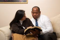 Mixed Raced Christian Couple Studying Bible Together stock image