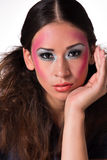 Mixed raced girl with extreme make-up looking royalty free stock photography