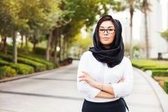 Mixed raced muslim woman on a street of Dubai city stock photos