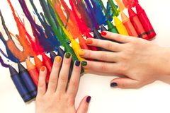 Mixed rainbow children`s manicure and drawing . Stock Images