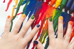 Mixed rainbow children`s manicure and drawing . Royalty Free Stock Photos