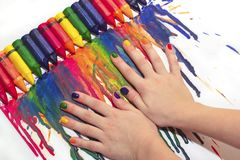 Mixed rainbow children`s manicure and drawing . Stock Photo