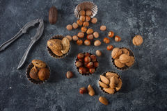 Mixed raw nuts in nutshells - hazelnut, walnut, almond and nutmeg. Healthy lifestyle, dietary product. Stock Photography