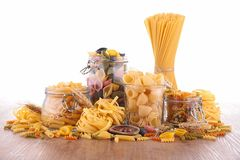 Mixed raw pasta. On wood Stock Images