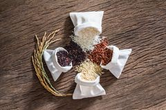 Mixed raw rice, Jasmine rice, Brown rice, Black jasmine rice and Riceberry stock photo