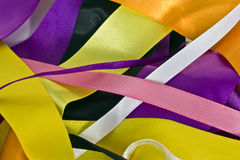ribbons background. A close-up of mixed coloured satin ribbons Stock Photo