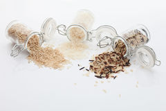 Mixed rice grains in glass jars on white background Royalty Free Stock Photo
