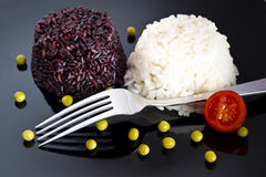 Mixed rice with green peas  on black plate Royalty Free Stock Photos