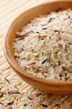 Mixed rice. Wooden bowl full of mixed rice.(Wild,brown and basmati rice Royalty Free Stock Photos