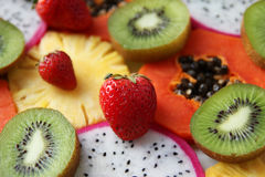 Mixed ripe and fresh fruits and berries close up for background. Royalty Free Stock Images