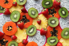 Mixed ripe and fresh fruits and berries close up for background. Stock Photos
