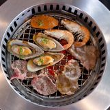 Mixed Roasted Meat and Seafood on the BBQ Grill on roast. Royalty Free Stock Photos