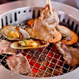 Mixed Roasted Meat and Seafood and Chopsticks on the BBQ Grill o Royalty Free Stock Photos