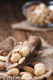 Mixed roasted and salted nuts Stock Photos