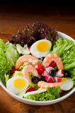 Mixed salad. With shrimp and eggs on white bowl Royalty Free Stock Images