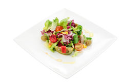Mixed salad. Mediterranean salad with natural ingredients for a balanced diet and isolated cropped Stock Photos