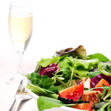 Mixed Salad. And a glass of wine on white background Stock Photography