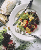 Mixed salad. Mixed summer salad with chicken and olives Royalty Free Stock Photography