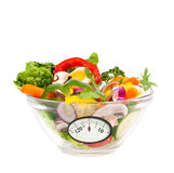 Mixed salad with analogous weight scale Royalty Free Stock Images