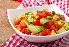 Mixed salad with avocado, tomatoes and sweet corn Royalty Free Stock Image