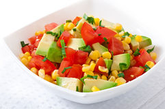 Mixed salad with avocado, tomatoes and sweet corn Stock Image