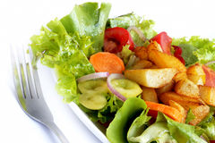 Mixed salad with baked potatoes. Salad with fresh vegetables,onion and carrots,healthy food Royalty Free Stock Image